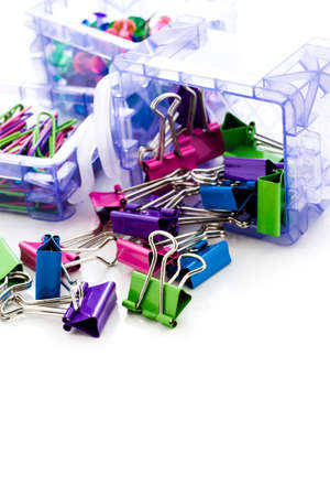 Multicolored paper clips in a pile on a white background. Stock Photo - 23173216