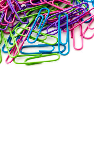 Multicolored paper clips in a pile on a white background. Stock Photo - 23173275