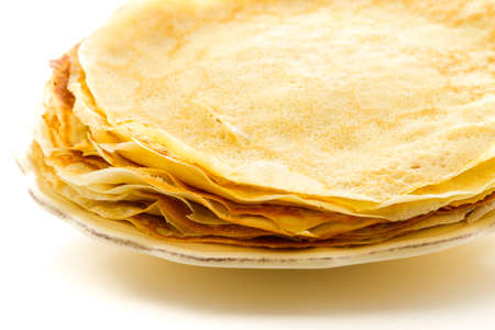 Freshly homemade crepes on a white background.
