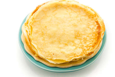 Freshly homemade crepes on a white .
