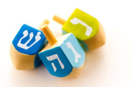 dreidels: A still life composed of elements of the Jewish ChanukahHanukkah festival.
