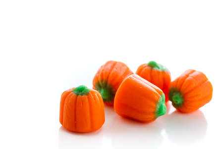 Halloween candy pumpkins on a white background.
