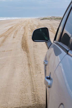cameron county: Driving on the baech of South Padre Island.