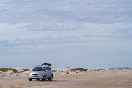 fine particles: Driving on the baech of South Padre Island.