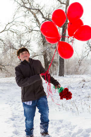 Teenager boy with Valentines Day gifts for his girlfriend. Reklamní fotografie