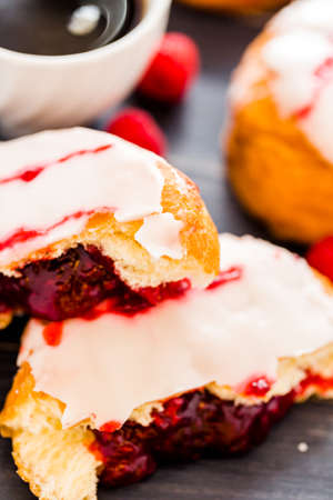 Fresh raspberry jelly filled donuts with white glazing on top. Stock Photo - 25843992