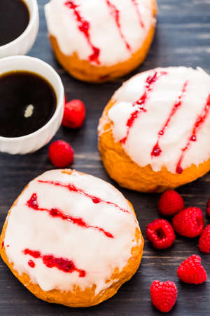 Fresh raspberry jelly filled donuts with white glazing on top. Stock Photo - 25844295