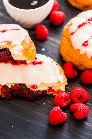 energizing: Fresh raspberry jelly filled donuts with white glazing on top.