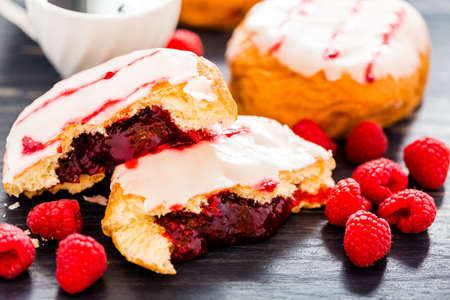 Fresh raspberry jelly filled donuts with white glazing on top. Stock Photo - 25844352