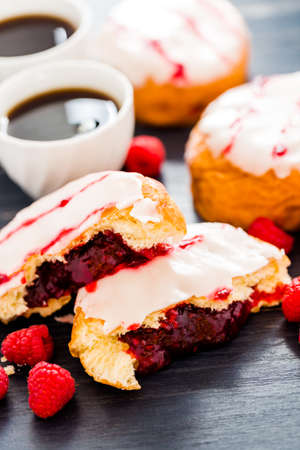 Fresh raspberry jelly filled donuts with white glazing on top. Stock Photo - 25844353