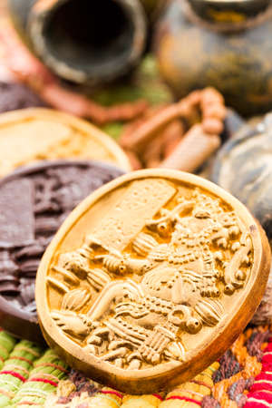 mesoamerica: Gourmet Maya glyphs in dark chocolate covered with gold dusting. Stock Photo