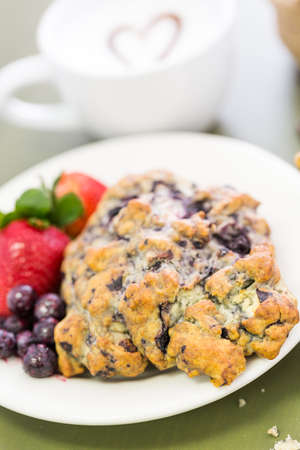 energizing: Cappuccino with fresh blueberry scone for breakfast. Stock Photo