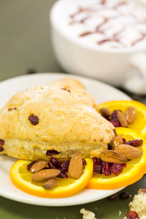 Cappuccino with fresh cranberry orange scone for breakfast. photo