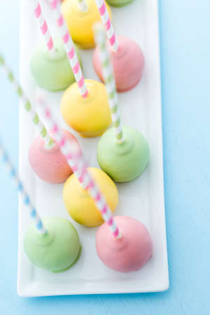 Easter cake pops on fancy fun straws. photo