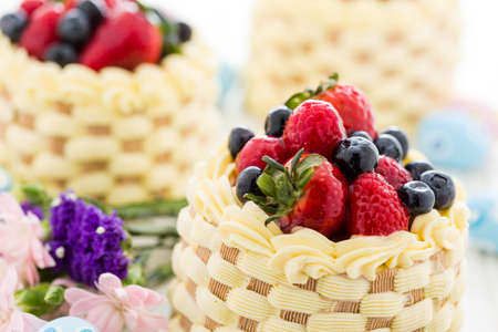 fragaria: Easter basket mini cakes with glazed fresh fruit on top.