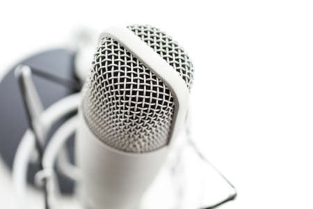 podcasting: Studio microphone for recording podcasts on a white background.
