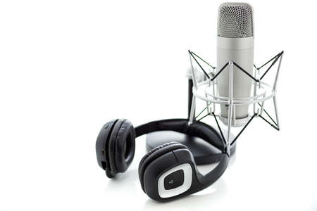 Studio microphone for recording podcasts with headset on a white background. Archivio Fotografico