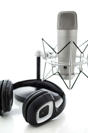 podcasting: Studio microphone for recording podcasts with headset on a white background. Stock Photo