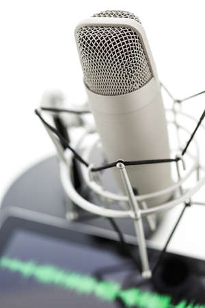podcasting: Studio microphone for recording podcasts and computer tablet on a white background. Stock Photo