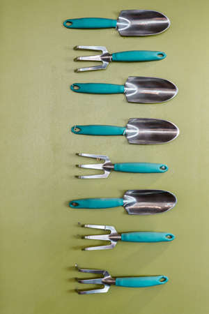 Garden tools are mounted on the wall as art.