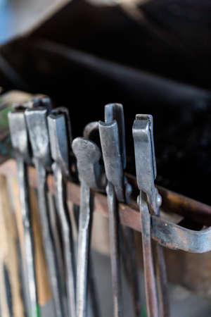 Tools of the blacksmith in blacksmith shop.