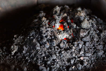 Coal in the forge of blacksmith shop.