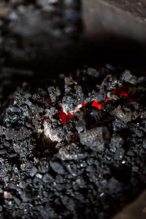 forge: Coal in the forge of blacksmith shop.