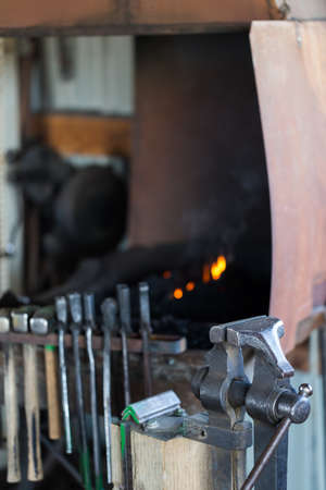 forge: Working forge of the blacksmith in old shop.