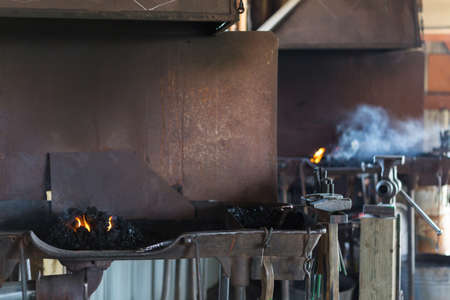 Working forge of the blacksmith in old shop.