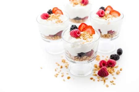 parfait: Breakfast parfait made from Greek yogurt and granola topped with fresh berries. Stock Photo