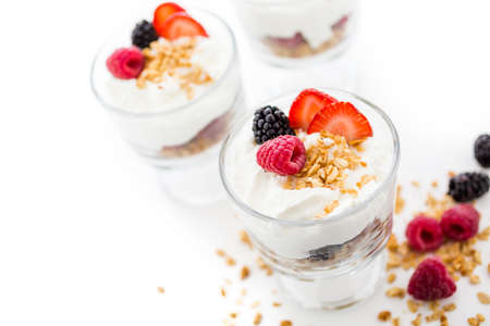caneberries: Breakfast parfait made from Greek yogurt and granola topped with fresh berries. Stock Photo