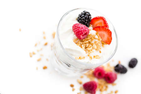 fragaria: Breakfast parfait made from Greek yogurt and granola topped with fresh berries. Stock Photo