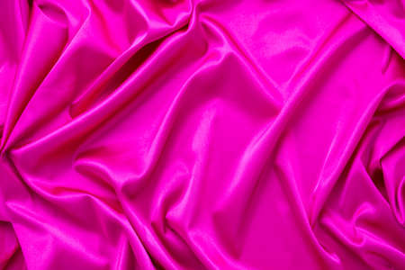 Pink silk fabric with waves.