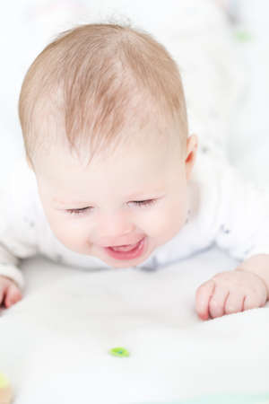 tummy time: Baby girl having fun on tummy time.
