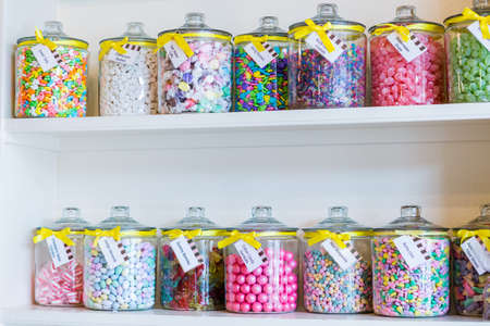Jars filled with different candies at the boutique candy store. photo