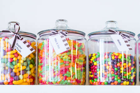 tagged: Jars filled with different candies at the boutique candy store. Stock Photo