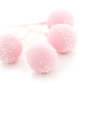 Pink cake pops on a white background. photo