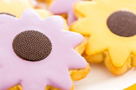baked treat: Easter sugar cookies in shape of flower with chocolate icing.