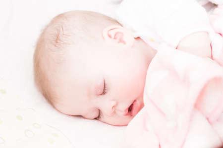 Cute baby girl sleeping in her crib. Archivio Fotografico