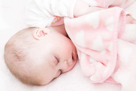 Cute baby girl sleeping in her crib. photo