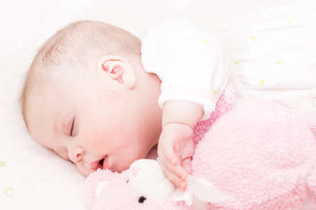 Cute baby girl sleeping in her crib. 版權商用圖片