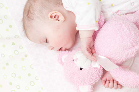 Cute baby girl sleeping in her crib. photo