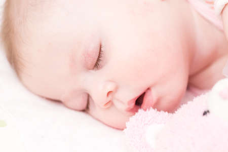 Cute baby girl sleeping in her crib. Stok Fotoğraf