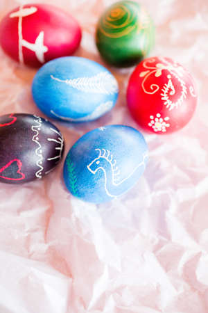 resist: Hand painted Ukrainian Easter eggs decorated with folk designs using a wax resist method.