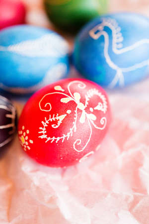 Hand painted Ukrainian Easter eggs decorated with folk designs using a wax resist method.