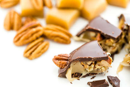whole pecans: Gourmet Caramel Pecan Turtles made with milk chocolate and whole pecans. Stock Photo