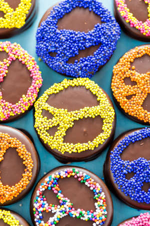 Gourmet Chocolate covered Oreos with colorful sprinkles on top. photo