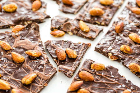 Gourmet slab of Almond Bark on a white background.