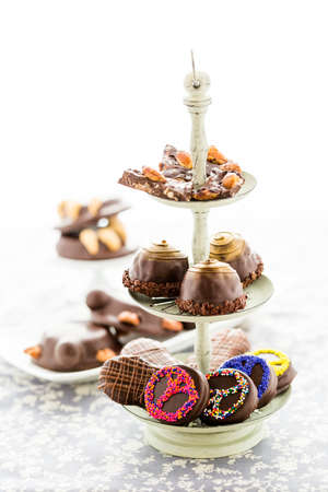 Veriety of gourmet chocolate confectionery with fun decor.