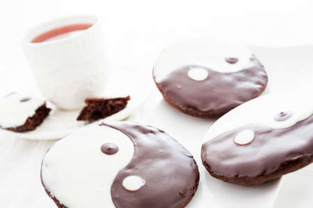 chinese philosophy: Gourmet yin and yang cookies with black and white icing.